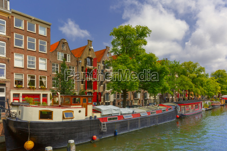 amsterdam canal with houseboats holland