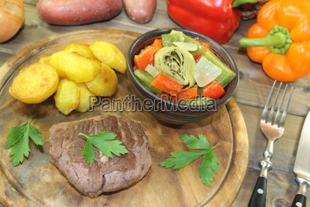 ostrich steaks with oven potatoes and