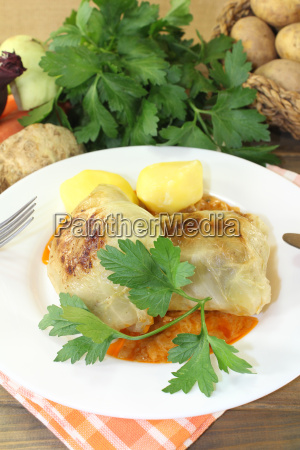 braised cabbage roulade with potatoes and