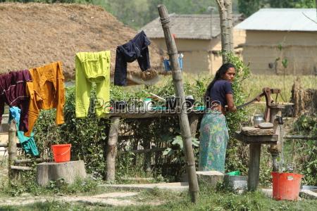 woman taking water in nepal