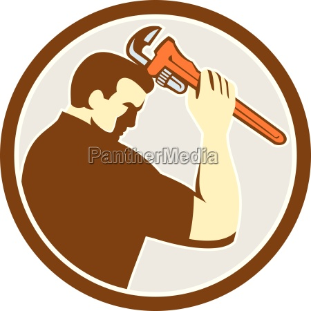 plumber holding monkey wrench side circle