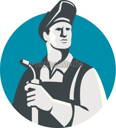 welder holding welding torch circle retro