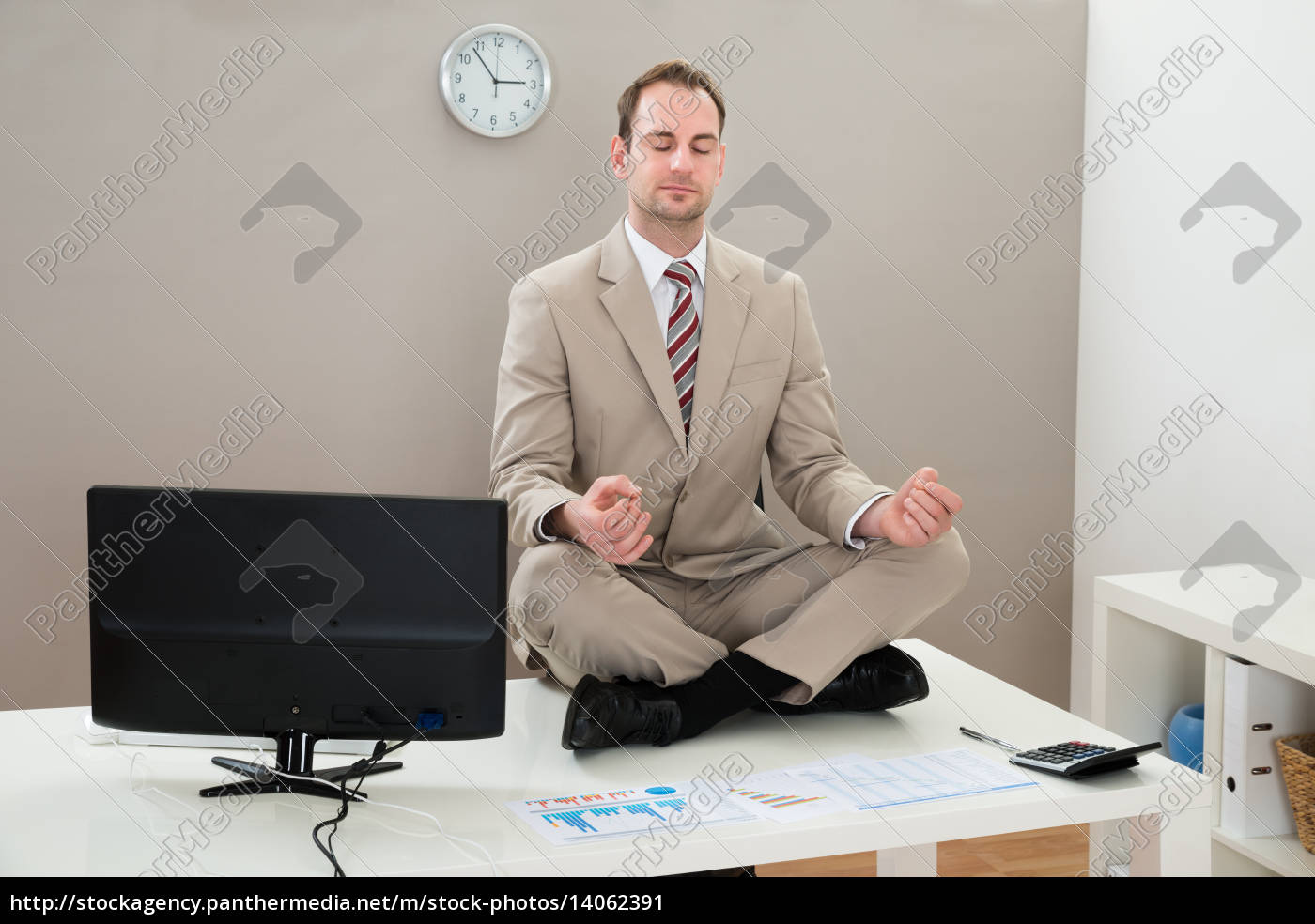 businessman, meditating, with, eyes, closed - 14062391