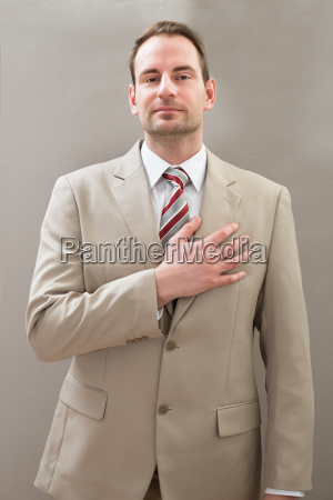 businessman, with, hands, on, chest - 14062425