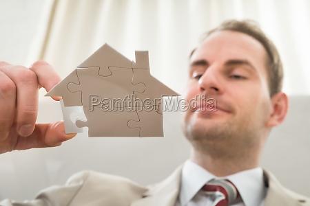 businessman, with, house, shape, puzzle - 14062991