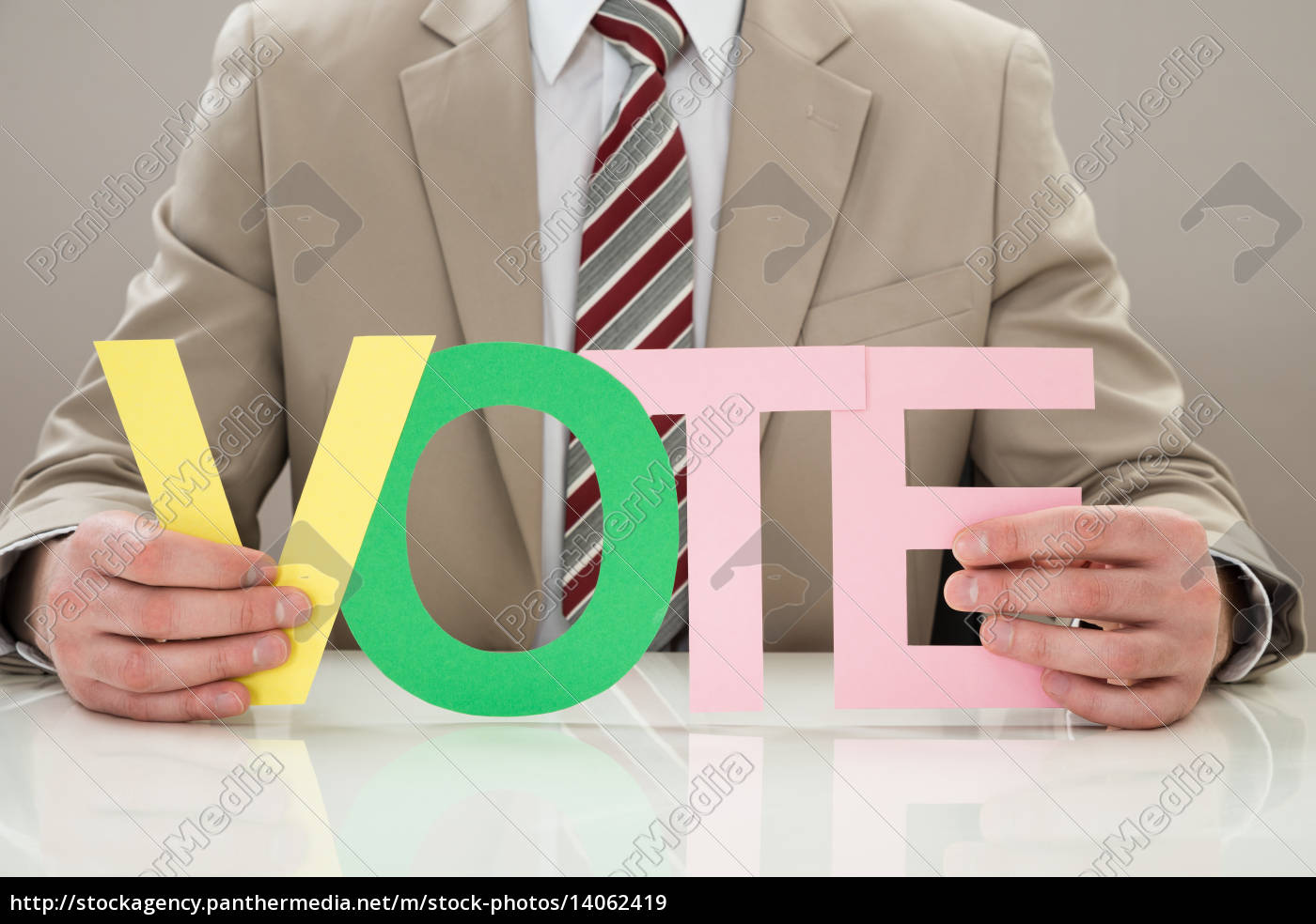 businessperson, with, the, word, vote - 14062419