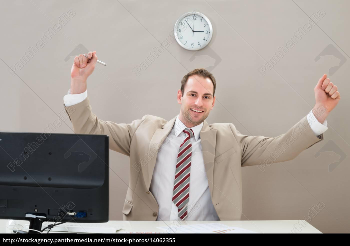 happy, businessman, at, desk - 14062355