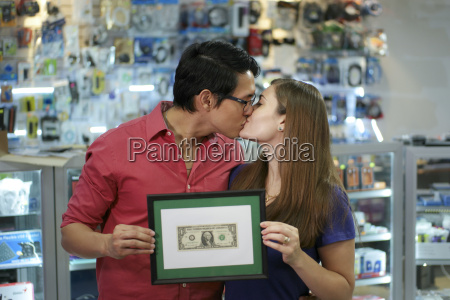 happy, shop, owners, kissing, and, showing - 14062783