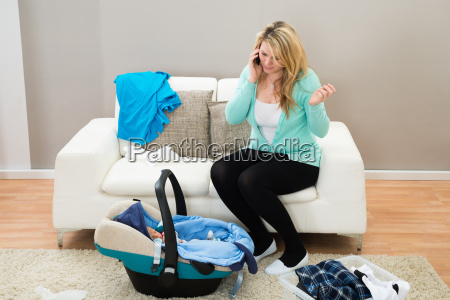 woman, talking, on, mobile, in, living - 14062471