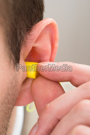 yellow, earplug, into, the, ear - 14062457