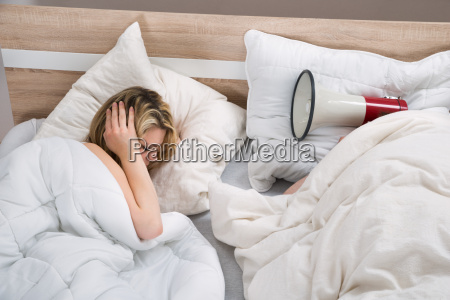 couple, with, duvet, in, bedroom - 14063053