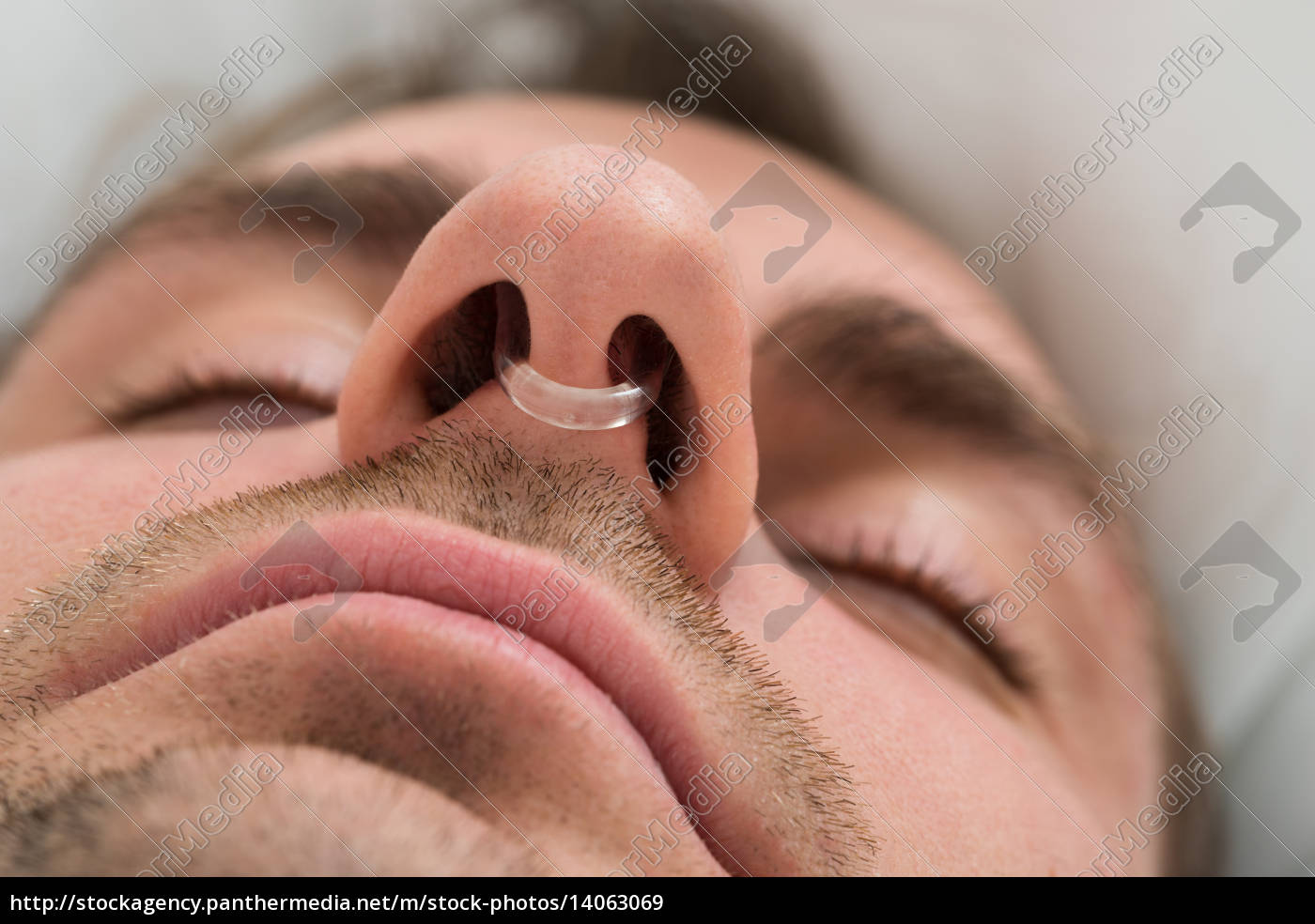 man, face, with, nose, clip, device - 14063069