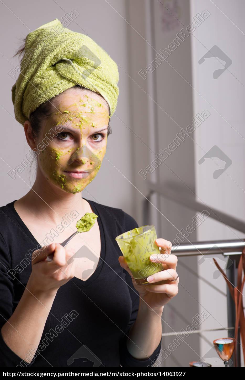 young, woman, with, an, avocado, facial - 14063927