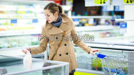beautiful young woman shopping for fruits