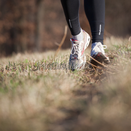 jogging, outdoors, in, a, meadow, (shallow - 14064685
