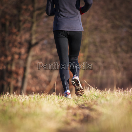 jogging, outdoors, in, a, meadow, (shallow - 14064689