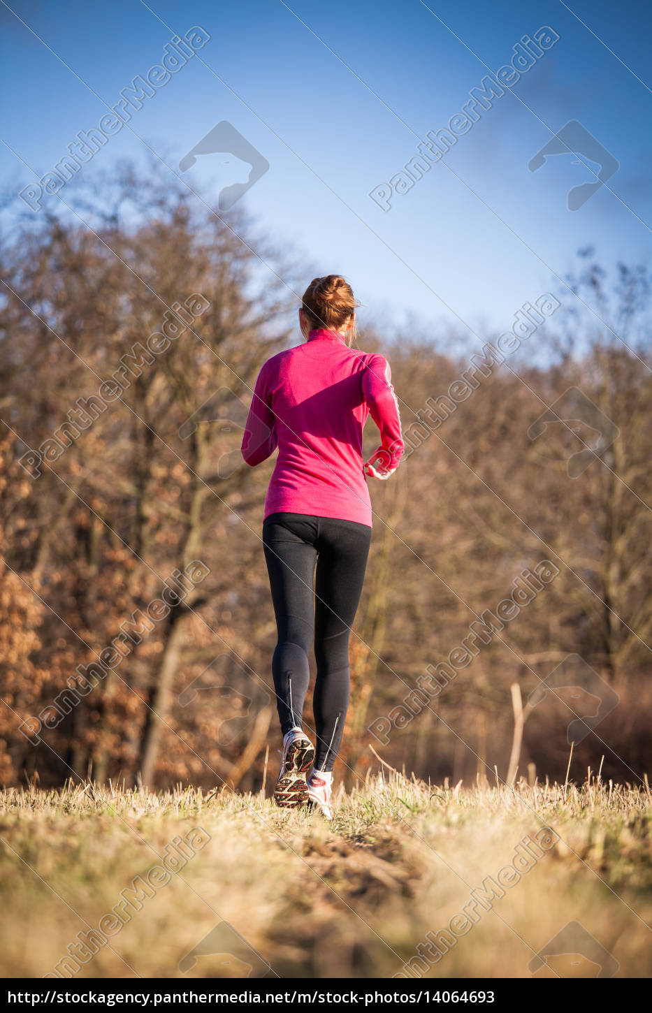 young, woman, running, outdoors, on, a - 14064693