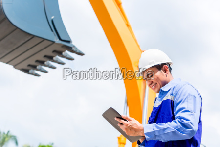 asian, engineer, checking, plans, on, construction - 14065359