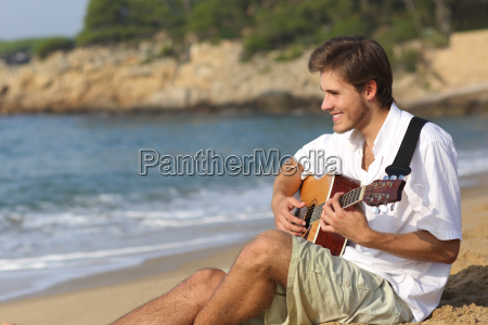 handsome man playing classic guitar on
