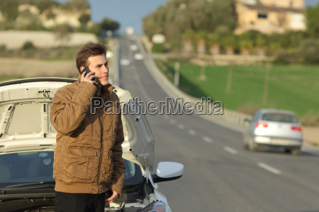 happy man calling roadside assistance for