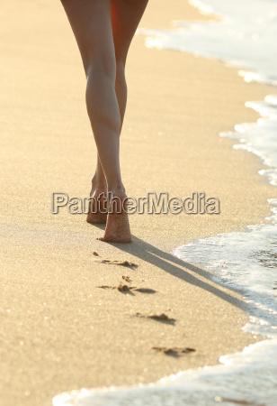 backlit of a woman legs walking