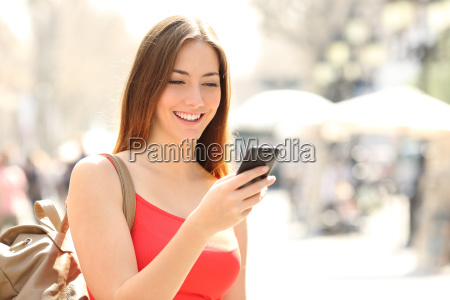 woman, using, a, smart, phone, in - 14067025