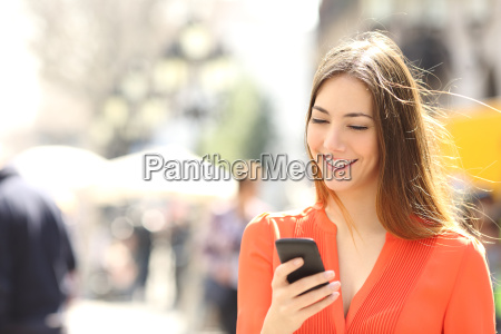 woman, wearing, orange, shirt, texting, on - 14067021