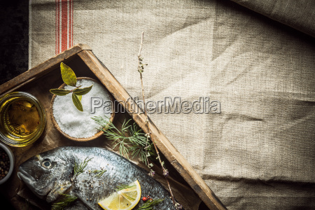 fresh fish and rubbing spice on