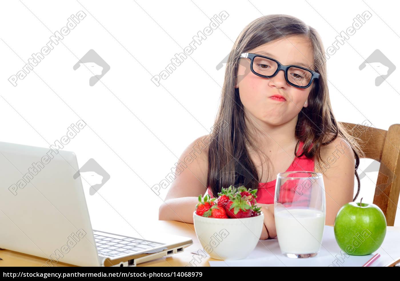 a, little, girl, at, her, desk - 14068979