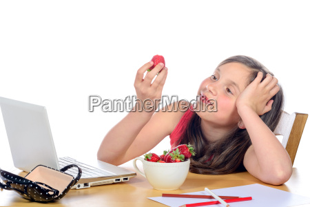 a, little, girl, eating, a, strawberry - 14068987