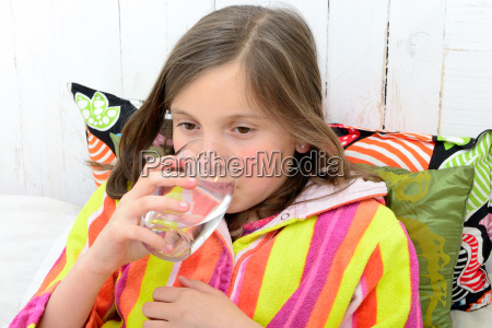 a, sick, girl, drinking, a, glass - 14068763