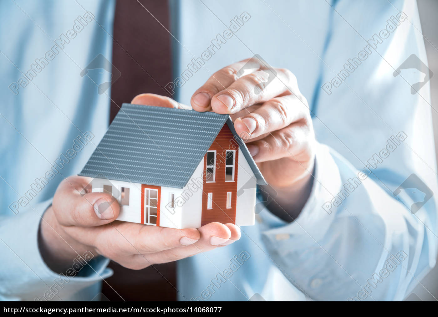 businessman, holding, a, cute, miniature, house - 14068077