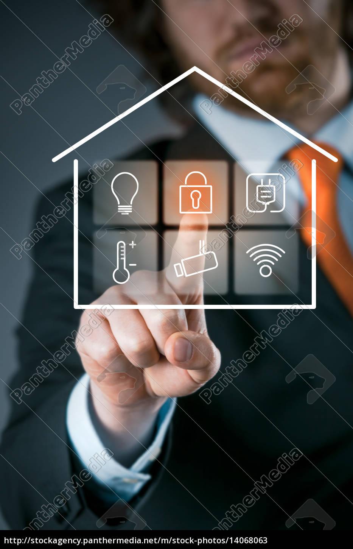 businessman, using, a, smart, house, control - 14068063