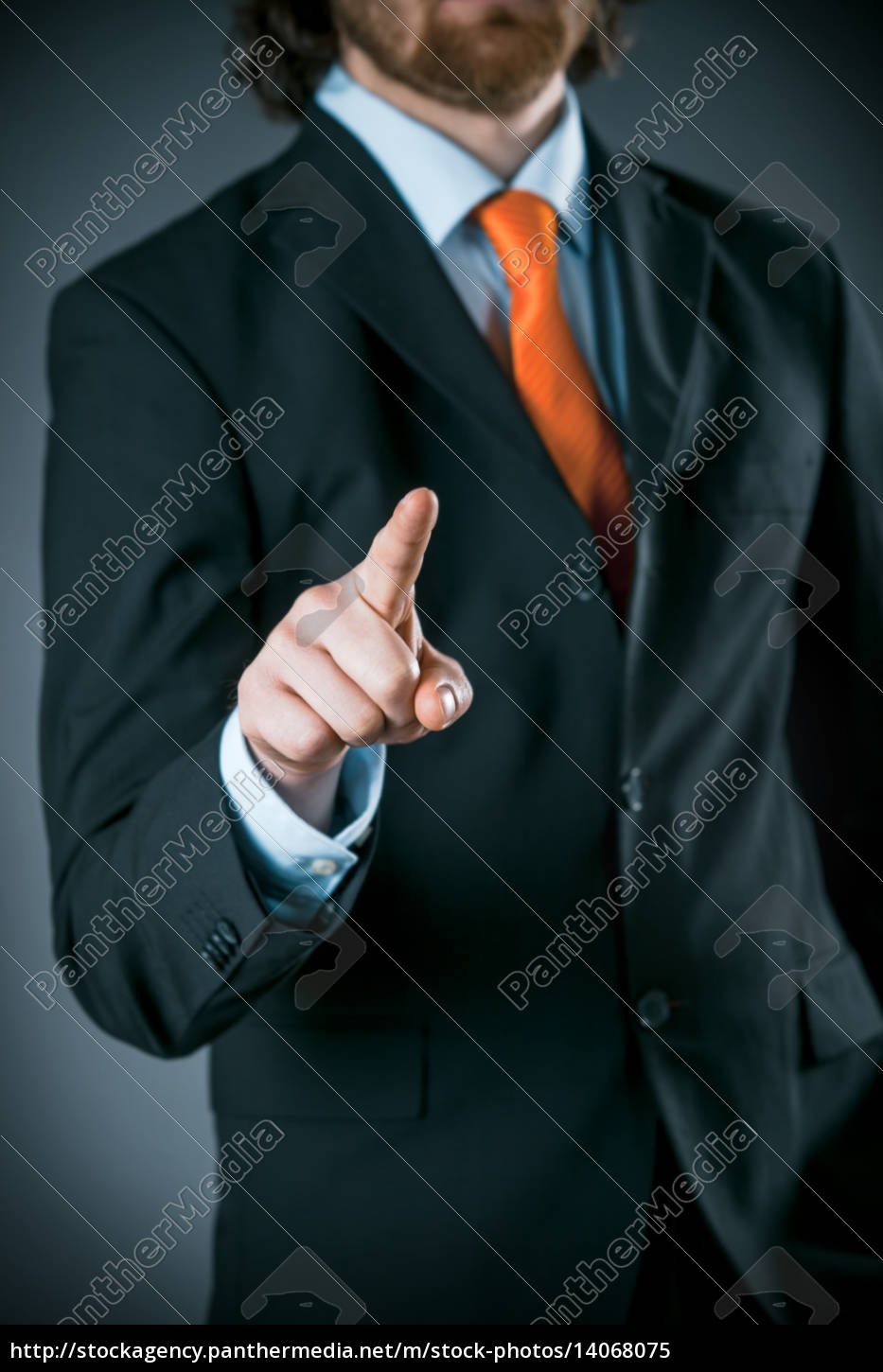 businessman, wearing, black, suit, pointing, at - 14068075