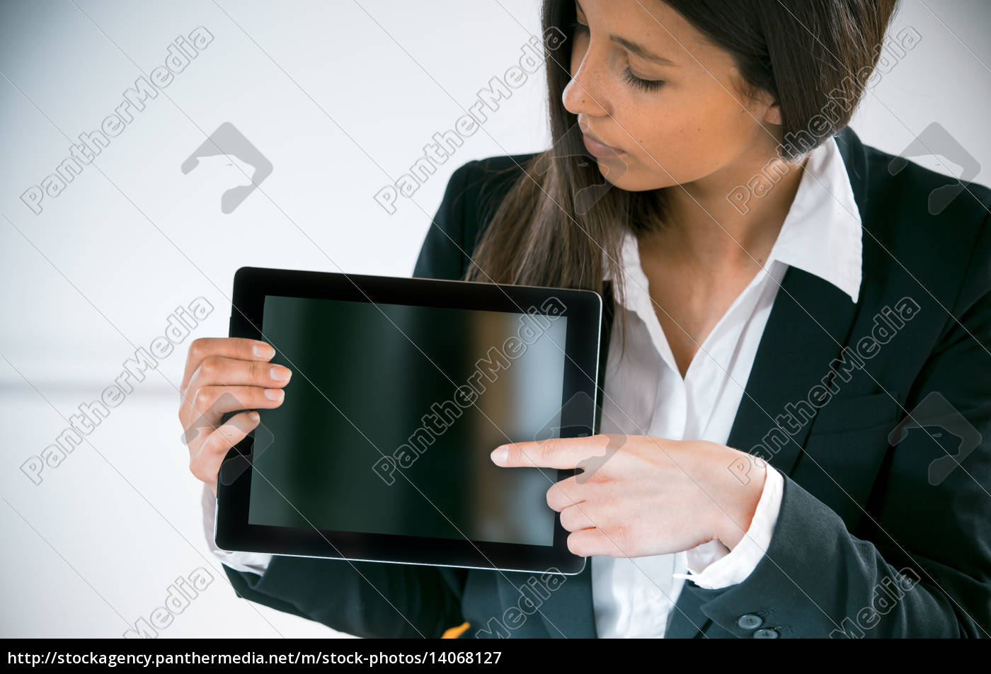 businesswoman, displaying, a, tablet, screen - 14068127