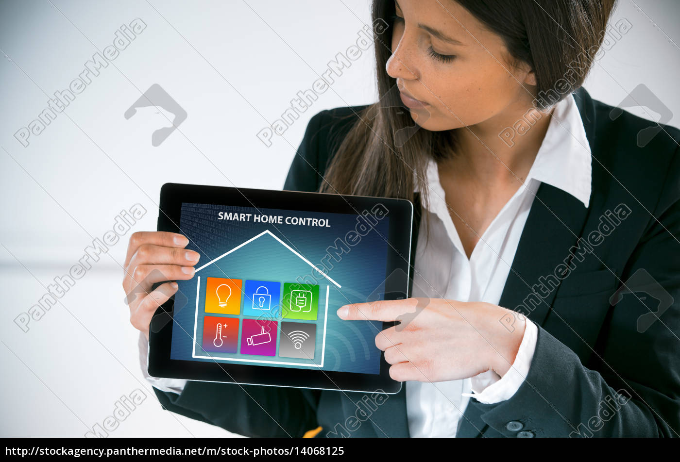 businesswoman, pointing, to, a, smart, house - 14068125