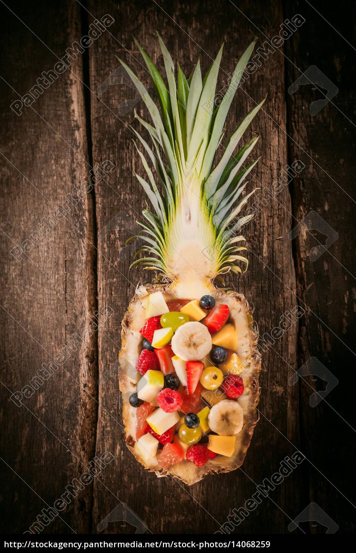 fruit, salad, served, in, a, carved - 14068259