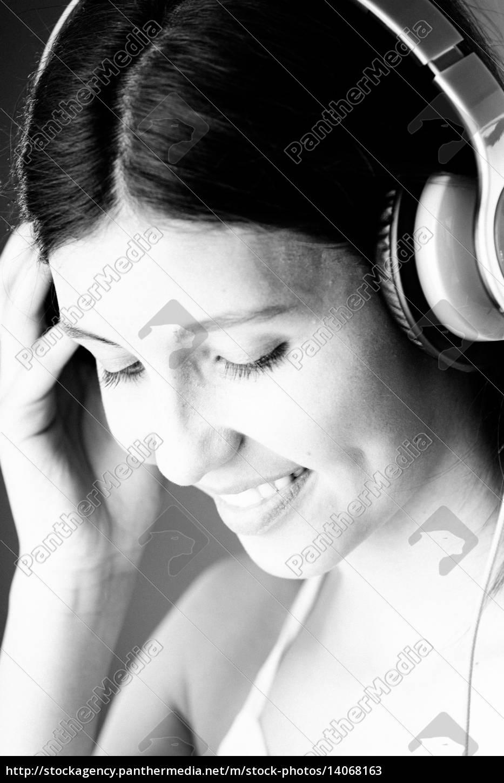 happy, thoughtful, woman, enjoying, music, on - 14068163