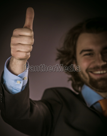 happy, young, businessman, showing, thumbs, up - 14068083