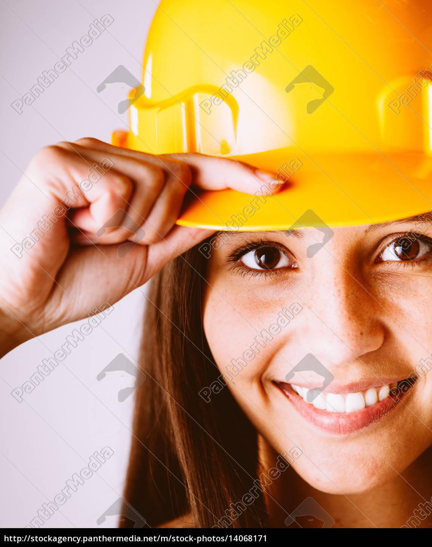 pretty, woman, wearing, yellow, protection, helmet - 14068171
