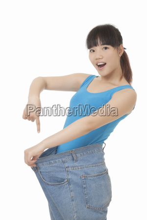beautiful asian woman wearing fat jeans
