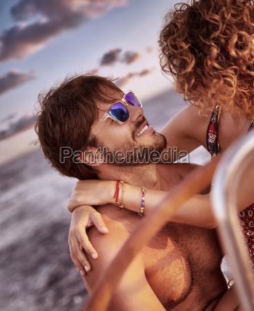 happy, loving, couple, on, sailboat - 14070747