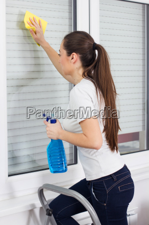 young, woman, cleaning, windows, glass - 14070049