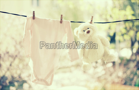 baby, clothes, hanging, on, the, clothesline - 14072573