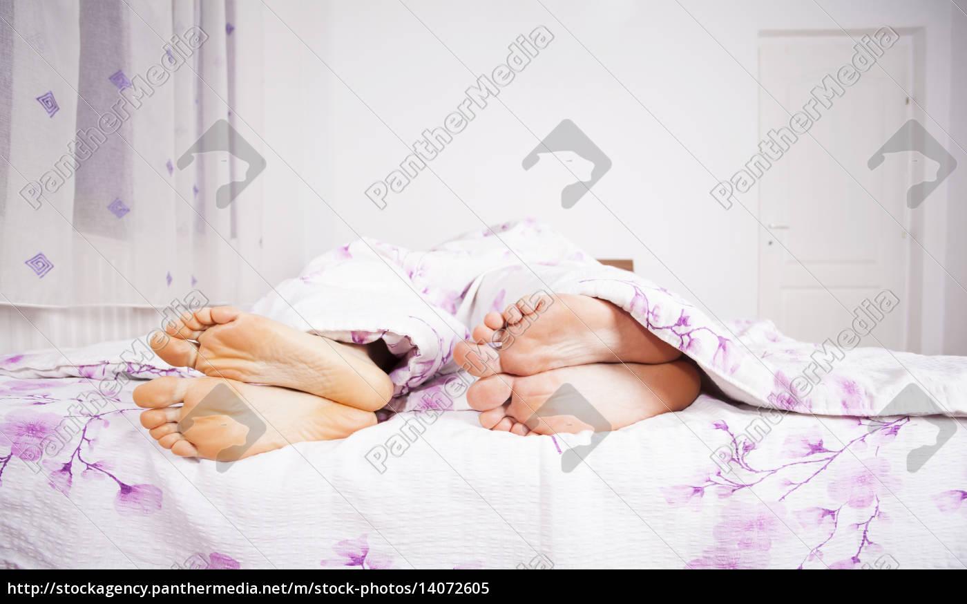 feet, of, a, couple, sleeping, side - 14072605