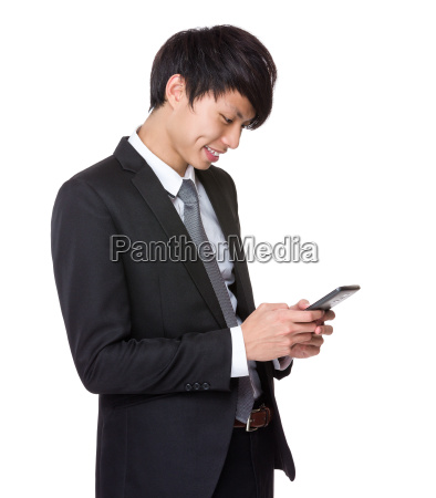 businessman, read, the, message, on, cellphone - 14073683