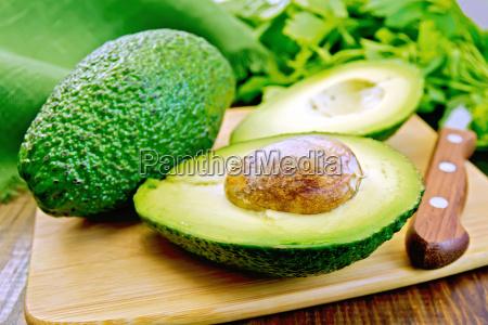 avocado with napkin on board