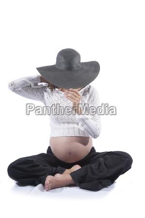 sitting pregnant hidden face