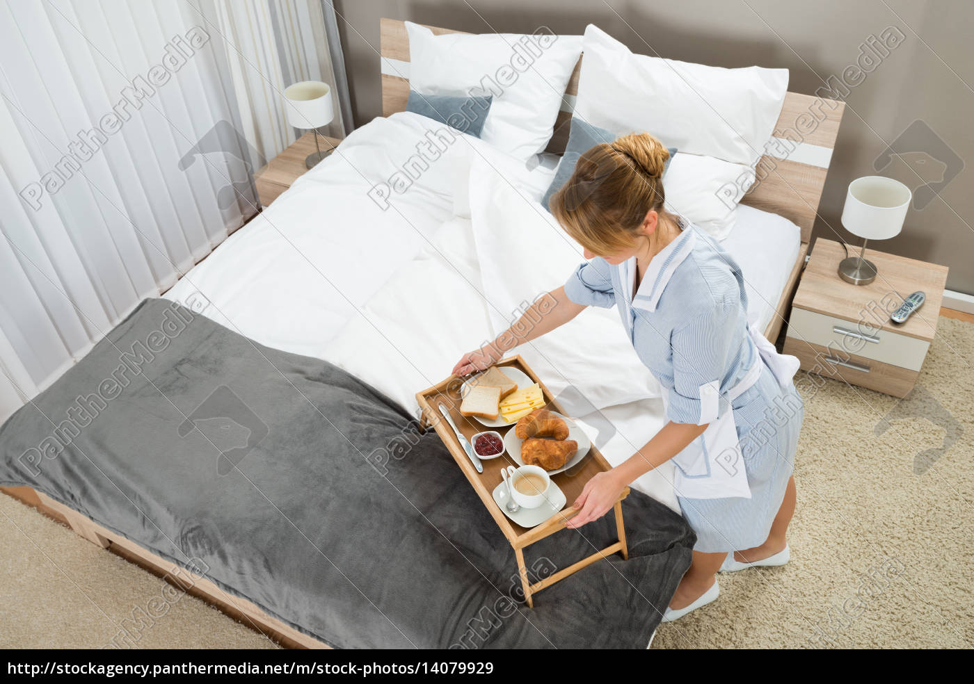 maid, with, breakfast, keeping, on, tray - 14079929