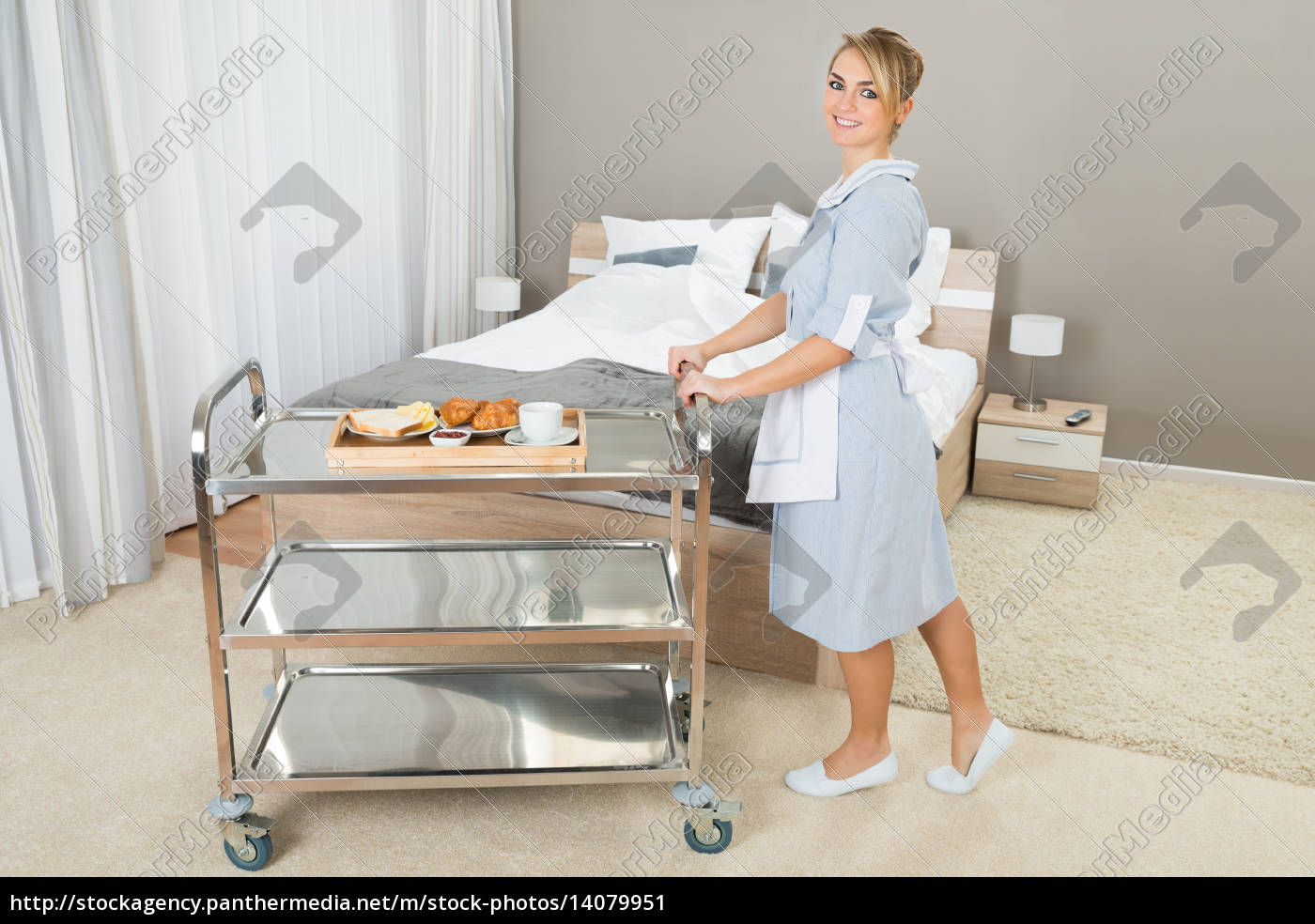 woman, pushing, trolley, with, breakfast - 14079951